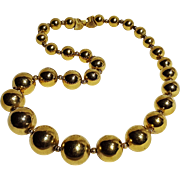Trifari gold tone metal bead necklace