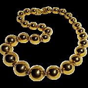Trifari gold tone metal bead necklace