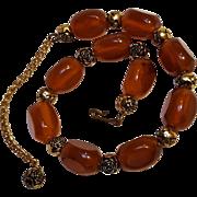 Caramel Bakelite bead necklace metal rose spacers