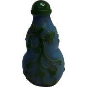 Double gourd glass snuff bottle green on blue overlay