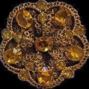 Circa 1930's gilt brass filigree dress clip hone yellow glass stones
