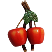 Laminated celluloid apples pin