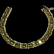 10K Gold peridot tennis bracelet emerald oval cut stones