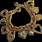 Kirks Folly heart charm bracelet rhinestone locket