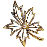 Napier rhinestone leaf pin simulated pearl center.