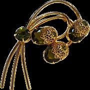 Sarah Coventry pin olivine rhinestone