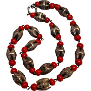 Embossed pinched metal and red glass bead necklace