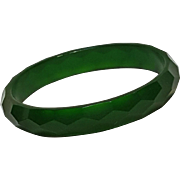 Faceted Bakelite bangle bracelet translucent green