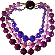 Faceted lucite bead necklace three strand glass clasp purple pink