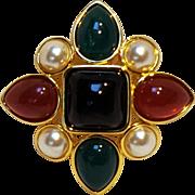 Joan River Maltese cross pin