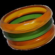 Carved Prystal Bakelite bangle set amber green