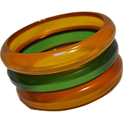 Carved Prystal Bakelite bangle bracelet set amber green