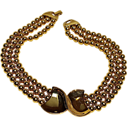 Napier choker necklace gold tone plaque three strands beads