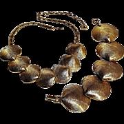 Clam shell motif bracelet necklace set