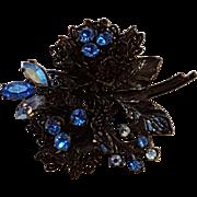 Coro flower pin Japanned finish filigree petals blue rhinestone