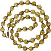 Yellow art glass beads foil core applied trail