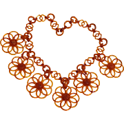 Plastic tortoise shell necklace with flower drops