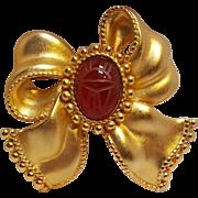 Erwin pearl bow ribbon pin scarab stone
