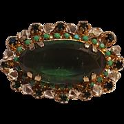 Green glass stone  pin white enamel flower frame