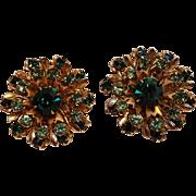 Green rhinestone starburst clip earrings