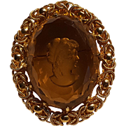 Glass intaglio cameo pin honey amber color