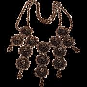 Bib necklace domed filigree plaques drops