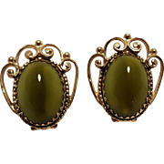 Whiting Davis green glass cabochon clip earrings