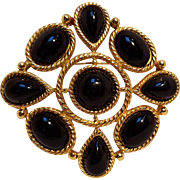 Trifari black lucite cabochon pin brooch