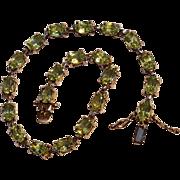 Sterling silver peridot gemstone line bracelet circa 1980's