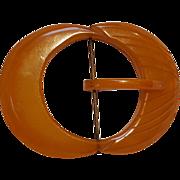 Carved translucent amber colored  Bakelite buckle WW2 era