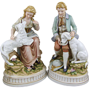 Bisque Porcelain Sculpture Pair Boy & Girl with Dogs