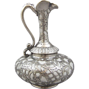 A Fine White Porcelain Chased Silver Overlay Ewer Pitcher