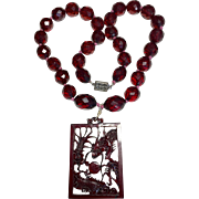 Vintage Chinese Silver Carved Cherry Amber Bakelite Dragon Pendant and Faceted Beads 41 Grams