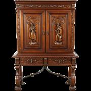Spanish Colonial Vintage Lighted Bar Cabinet, Carved Figures