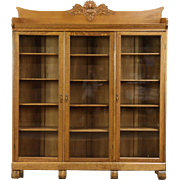 Oak Triple Antique Bookcase, Carved Northwind Face, Wavy Glass Doors