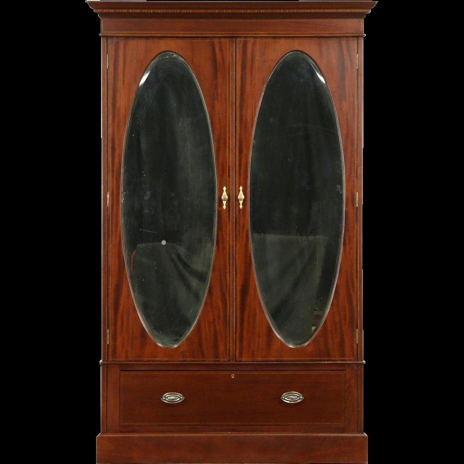 english 1910 antique armoire or wardrobe closet oval beveled mirror doors antique armoires antique wardrobes english