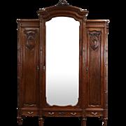 Italian Triple 1900 Antique Carved Walnut Armoire Wardrobe or Closet Mirror Door