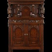 English Tudor 1925 Antique China or Bar Cabinet, Carved Oak & Burl