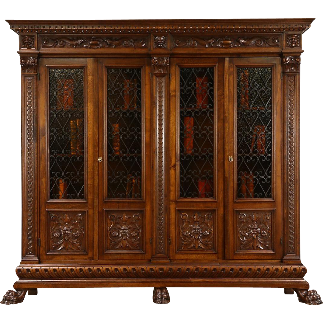 Italian 1890's Antique Bookcase, Carved Heads & Paws, Iron Grills, Stained Glass