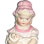 Antique Match Holder & Striker figurine: Darling Little Pink Girl holding her doll