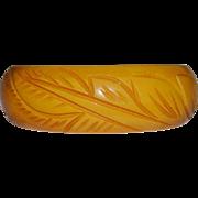 Butterscotch Bakelite Carved Bangle Bracelet Tropical Motif