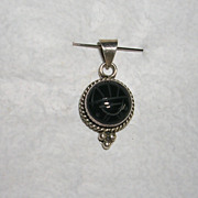 Sterling Silver and Carved Onyx Pendant