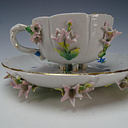 Antique KPM German Floral Encrusted Porcelain Cup and Saucer c1900