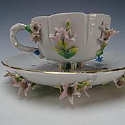 Antique KPM German Floral Encrusted Porcelain Cup and Saucer c1900