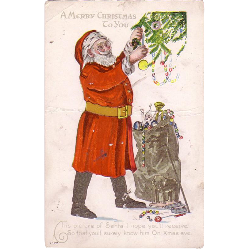 Christmas Postcard w/  Santa Claus decorating a Christmas Tree