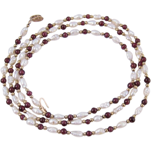 Vintage Mother of Pearl Garnets and 14k Yellow Gold Necklace 31 Inches