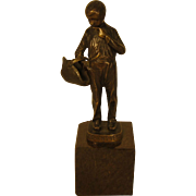 Bronze Sculpture of a Boy with a Basket by Ernst Beck (German, 1879-1941)