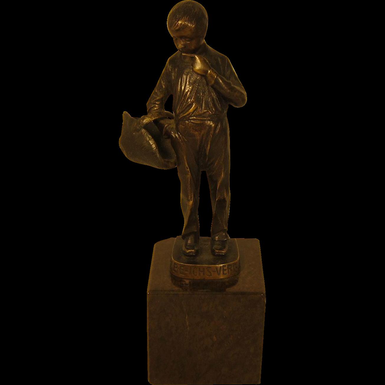 Bronze Sculpture of a Boy with a Basket by Ernst Beck (German, 1879-1941)
