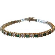 Stunning 14K Yellow Gold Emeralds and Diamonds Tennis Bracelet