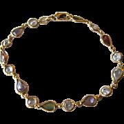 Vintage Italian 18K Yellow Gold and Garnets, Amethysts, Peridots Bracelet